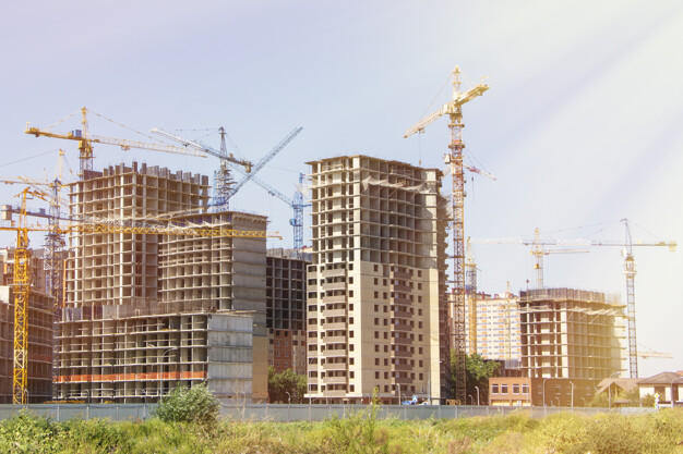 Construction site background. Hoisting cranes and new multi-storey buildings. tower crane and unfinished high-rise building. many cranes. construction of a new district of the city